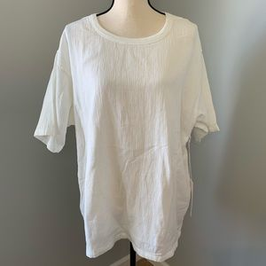 Relaxed fit ivory short sleeve shirt. NWT